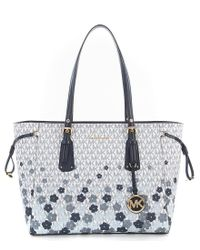 MICHAEL Michael Kors - Blue Voyager Signature Floral Multifunction Tote - Lyst