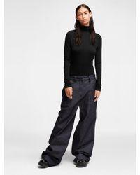 DKNY - Black Long Sleeve Viscose Bodysuit - Lyst