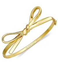 kate spade new york | Metallic 12K Gold-Plated Skinny Mini Bow Bangle Bracelet | Lyst