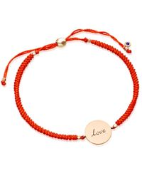 Biography | Pink Hot Coral Love Disc Bracelet | Lyst