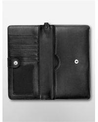 Calvin Klein | Black White Label Valerie Large Tech Wrist Wallet | Lyst