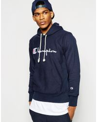 5744ad4f2273 Lyst - Champion Hoodie With Script Logo in Blue for Men