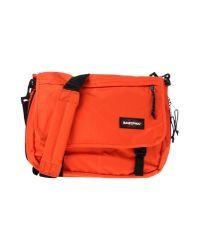Eastpak - Orange Cross-body Bag for Men - Lyst
