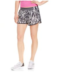 Under Armour | Black Perfect Pace Woven Printed Shorts | Lyst