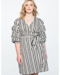 e3b2b4f95ce8 Lyst - Eloquii Printed Tucked Puff Sleeve Wrap Dress in Black
