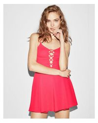 Express - Pink Solid Lattice Front Romper - Lyst