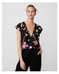 Express - Black Roll Sleeve Deep-v Neck Floral Blouse - Lyst