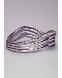 Bebe - Metallic Wavy Textured Bangle Set - Lyst