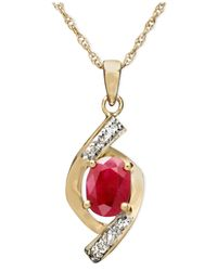 Macy's - Metallic 10k Gold Pendant, Ruby (3/4 Ct. T.w.) And Diamond Accent Oval Swirl - Lyst