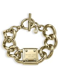 Michael Kors | Metallic Logo Plaque Curb Chain Toggle Bracelet | Lyst