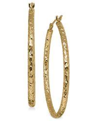 Macy's - Metallic Oval Tube Hoop Earrings In 10k Gold - Lyst