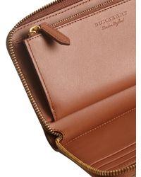 Burberry - Brown Embossed Ziparound Wallet - Lyst