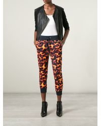 Love Moschino - Orange Flame Print Cropped Track Trousers - Lyst