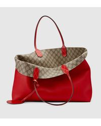 37bd25dc76b8 Gucci Reversible Gg Leather Tote in Red - Lyst