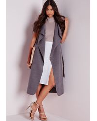 dc6bb7090ec888 Lyst - Missguided Sleeveless Belted Waterfall Coat Grey in Gray