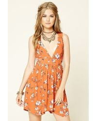 1e5c1d79203f6 Forever 21 Lace-up Back Floral Mini Dress in Orange - Lyst