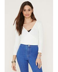 30a2aa9355 Lyst - Forever 21 Women s Ribbed Surplice Crop Top in White
