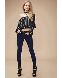 Forever 21 - Blue Mid-rise Clean Wash Skinny Jeans - Lyst