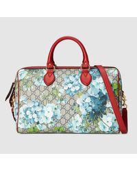 7e14a763d16a52 Gucci GG Blooms Supreme Top Handle Bag - Lyst