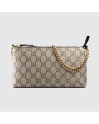 f234d957cd6 Lyst - Gucci Gg Supreme Canvas Wrist Wallet