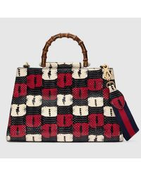 a98f12c6c6e Lyst - Gucci Nymphaea Snakeskin Top Handle Bag