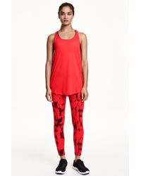 206b6a5eebeb7 H&M Sports Leggings in Red - Lyst