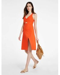 Halston - Orange Structured Dress With Front Cut Out - Lyst