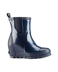 afef76e6113f Lyst - Sorel Joan Rain Wedge Chelsea Gloss Boot in Blue