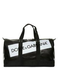 2442bcff28b5 Dolce   Gabbana Logo Tape Coated Canvas Duffle Bag in Black - Lyst