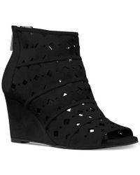 145fdc59b8f5 Lyst - Michael Kors Michael Uma Wedge Peep-toe Booties in Black