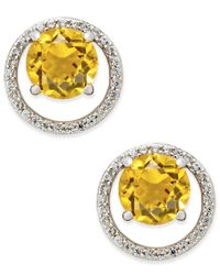 Macy's | Metallic Citrine (1-1/2 Ct. T.w.) And Diamond (1/6 Ct. T.w.) Round Halo Stud Earrings In Sterling Silver | Lyst
