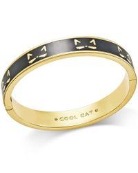 Kate Spade | Metallic Gold-tone Black Enamel Cool Cat Hinged Bangle Bracelet | Lyst