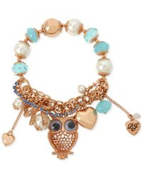 Betsey Johnson | Blue Rose Gold-tone Owl Stretch Charm Bracelet | Lyst