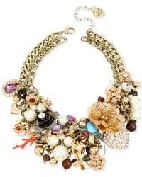 Betsey Johnson | Metallic Gold-tone Multi-charm Statement Necklace | Lyst