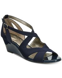c4194210f1d2 Lyst - Bandolino Omit Wedge Sandals in Blue
