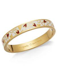 Kate Spade - Metallic Gold-tone Colored Heart Bangle Bracelet - Lyst