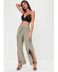 578c06d7fe648 Missguided Green Slinky Wrap Front Split Leg Trousers in Green - Lyst