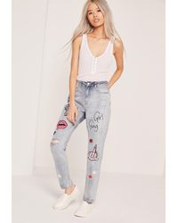 Missguided - Riot High Rise Girl Gang Badge Jeans Washed Blue - Lyst