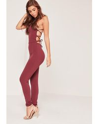 5c14ee4ec35 Women s Black Crepe Strappy Back Detail Unitard Jumpsuit Burgundy