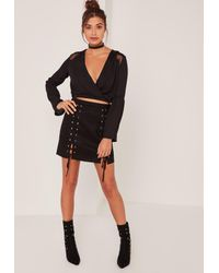 a6f110e002 Lyst - Missguided Black Faux Suede Eyelet Lace Up Mini Skirt in Black