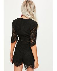 Missguided - Tall Black Lace Plunge Playsuit - Lyst