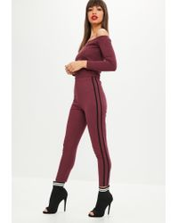4d21b1a4304 Missguided Petite Burgundy Bardot Jogger Jumpsuit in Red - Lyst