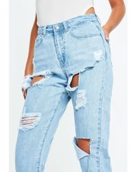 Missguided - Blue Stonewash Riot High Rise Ripped Denim Mom Jeans - Lyst