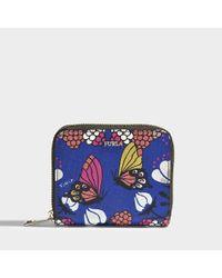 71575f3d8047d Lyst - Furla Babylon small Zip Around Geldbörse aus blauem Saffiano ...