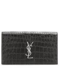 Saint Laurent | Black Classic Monogramme Embossed Leather Clutch | Lyst