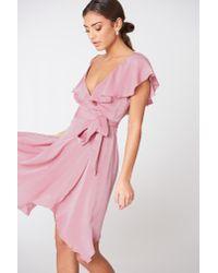 NA-KD Asymmetric Wrap Frill Dress Pink