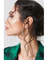 NA-KD Metallic Uneven Hoop Earrings Silver