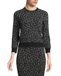 Michael Kors - Black Crewneck Leopard-print Stretch-viscose Pullover Top - Lyst