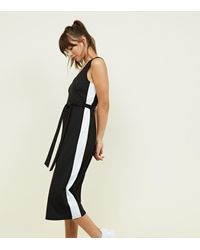 90107cb051b Gallery. Previously sold at  New Look · Women s Black Jumpsuits Women s  Striped ...