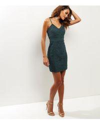 0cbd40a824 New Look Dark Green Lace Bodycon Dress in Green - Lyst